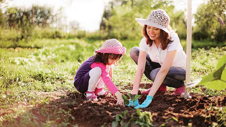 mother and young daughter gardening