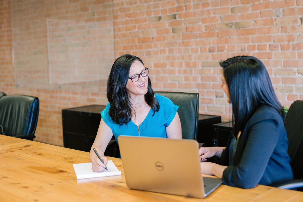 two women chatting during a job onboarding session