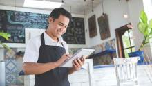 restaurant waiter taking order on smart tablet
